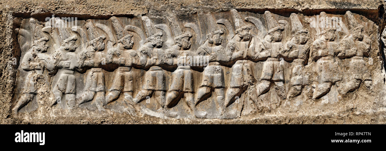 Sculpture of the twelve gods of the underworld from the 13th century BC Hittite religious rock carvings of Yazılıkaya Hittite rock sanctuary, chamber  - Stock Image