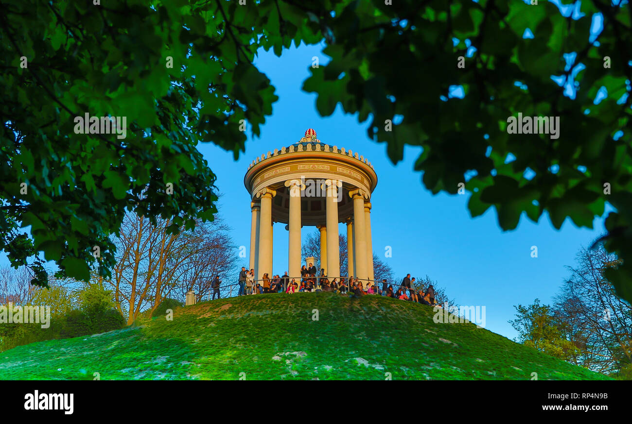 relaxing on monopteros in munich park Englischer Garten, travel bavaria - Stock Image