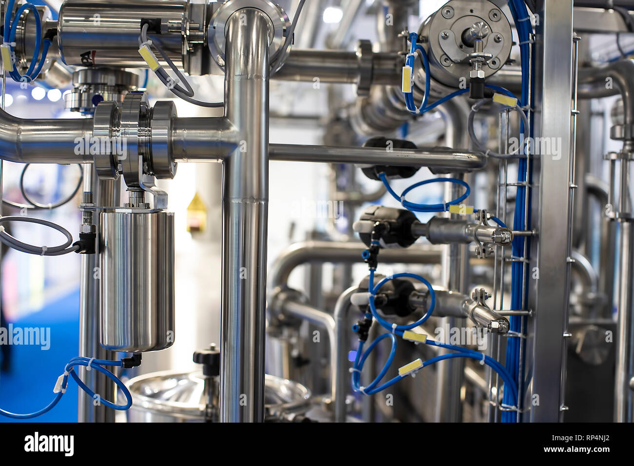 Stainless steel pipes in the factory. - Stock Image