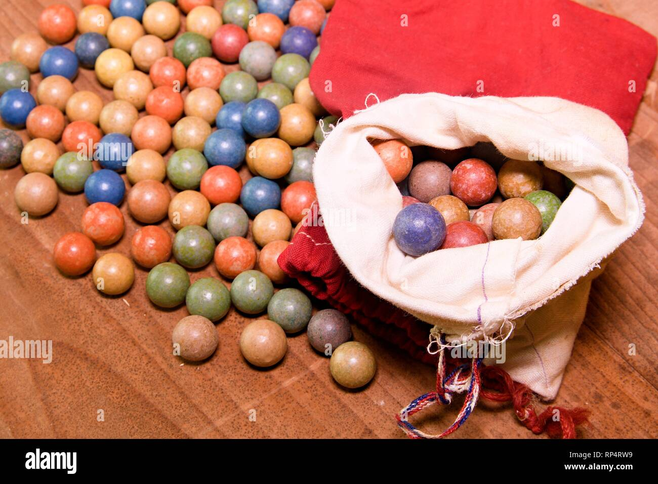Clay marbles (balls). Retro toys. Vintage toys. Shoot (roll/play) marbles - Stock Image