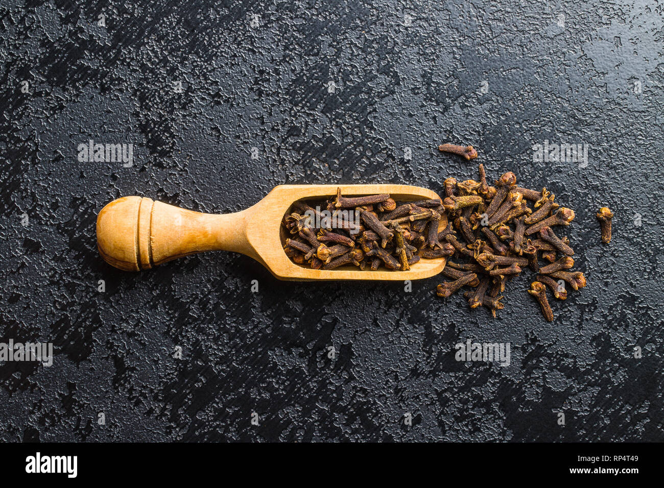 Carnation, dried clove spice in scoop. Stock Photo