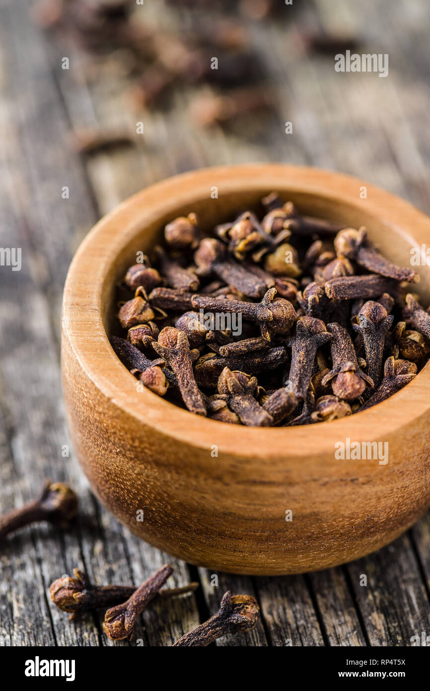 Carnation, dried clove spice in bowl. - Stock Image