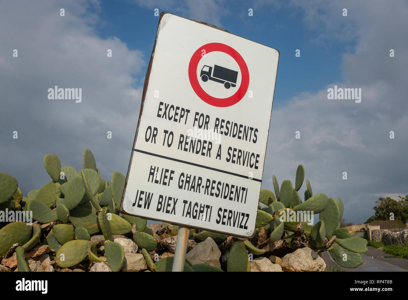 Road sign, 'Except for residents or to render a service'. No entry. Stock Photo