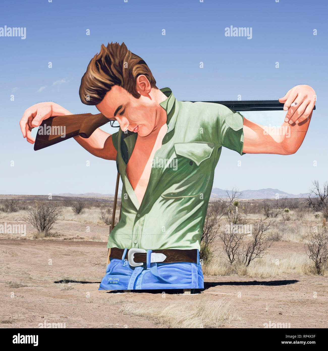 Cut-out effigy of actor James Dean, part of an open air exhibition on the site in west Texas where the movie Giant was filmed - Stock Image
