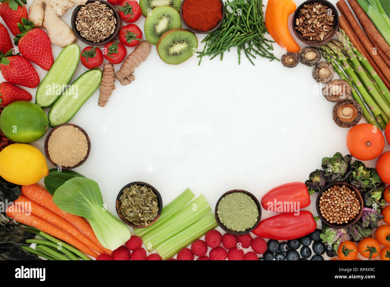 Liver detox health food background border  with fresh fruit, vegetables, herbs and spices also used in herbal medicine with supplement powders. - Stock Image