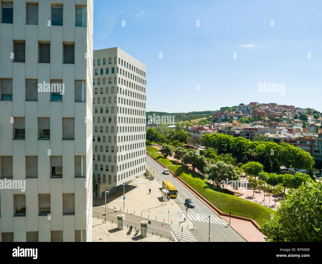 Aerial view of Barcelona Sapin with cars buses driving, highway and tall houses - Stock Image