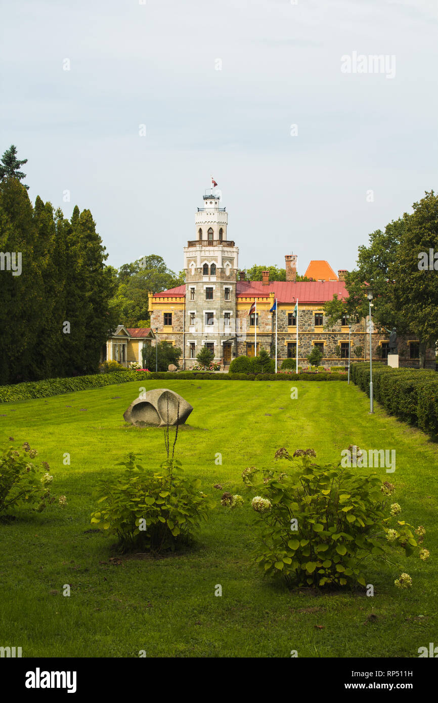 Front view of Sigulda New Castle / Siguldas jaunā pils with walking path during autumn (Riga area, Latvia, Europe) - Stock Image
