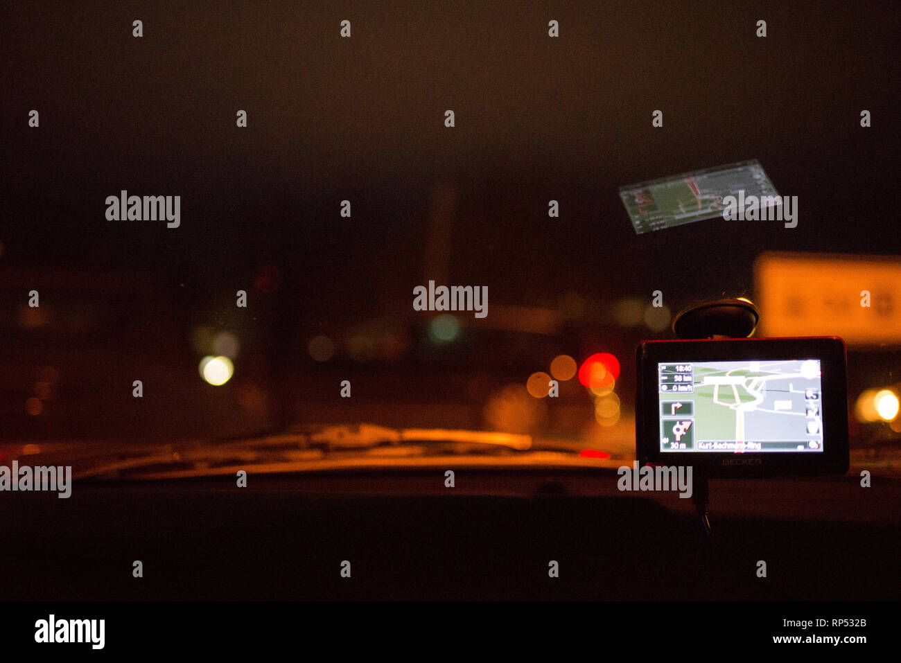 Navigation system in car at night GPS for click on at the windshield - Stock Image