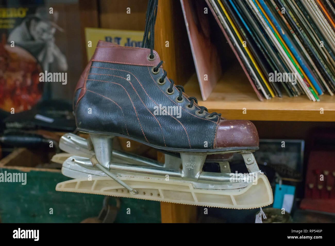 An old ice skate is found displayed at an antique store. - Stock Image