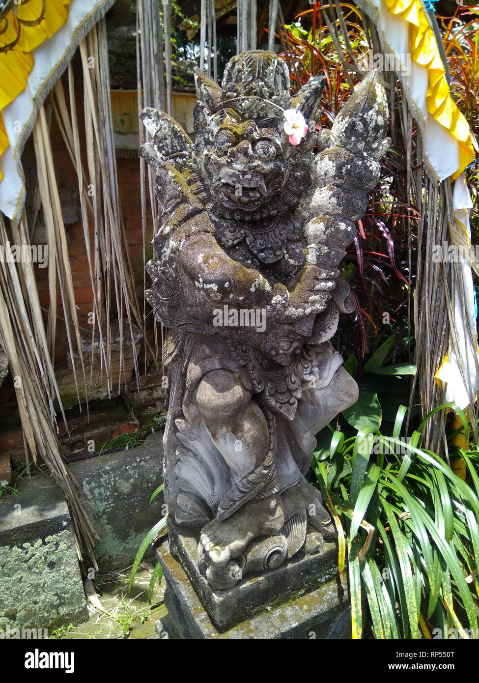 Ubud-Barong Lion Guard at Pura Tirta Tawar - Stock Image