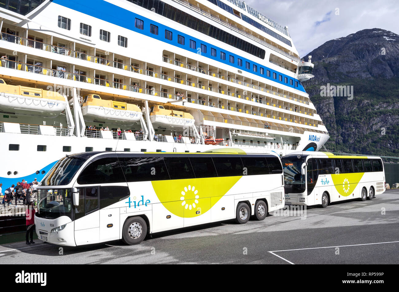 coaches of tide ASA waiting at AIDAsol for shore excursion passengers. Tide is one of the largest coach companies in Norway. - Stock Image