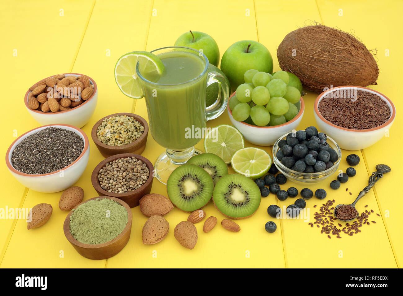 Vegan Health Food Smoothie Juice Drink With Fresh Fruit Matcha Powder Nuts Chia Flax And Hemp Husk Seed On Yellow Wood Background Stock Photo Alamy