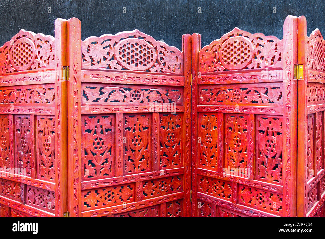 Beautiful hand carved retro wooden folding screen Stock Photo