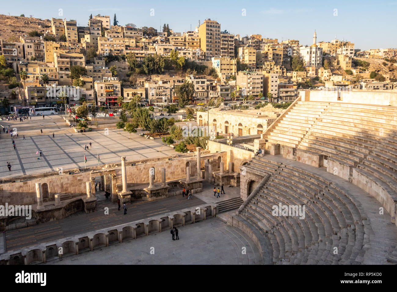 View of the Jordanian capital Amman, featuring the Roman amphitheatre and the smaller ancient amphitheatre Odeon, flanking the Hashemite Plaza. Stock Photo