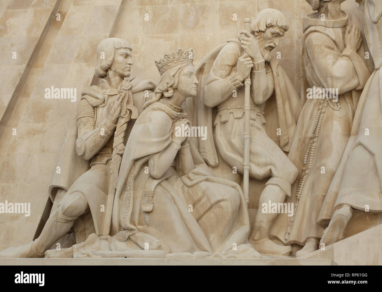 Duke Peter of Coimbra with his mother Queen Philippa of Lancaster and Portuguese explorer and writer Fernão Mendes Pinto (depicted from left to right) on the Monument of the Discoveries (Padrão dos Descobrimentos) designed by Portuguese sculptor Leopoldo de Almeida (1960) on the bank of the Tagus River in Belém district in Lisbon, Portugal. - Stock Image