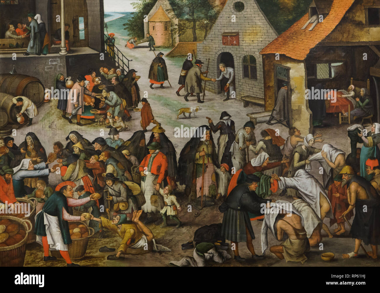 Painting 'Seven Acts of Mercy' by Dutch Renaissance painter Pieter Bruegel the Younger (1600-1605) on display in the National Museum of Ancient Art (Museu Nacional de Arte Antiga) in Lisbon, Portugal. - Stock Image