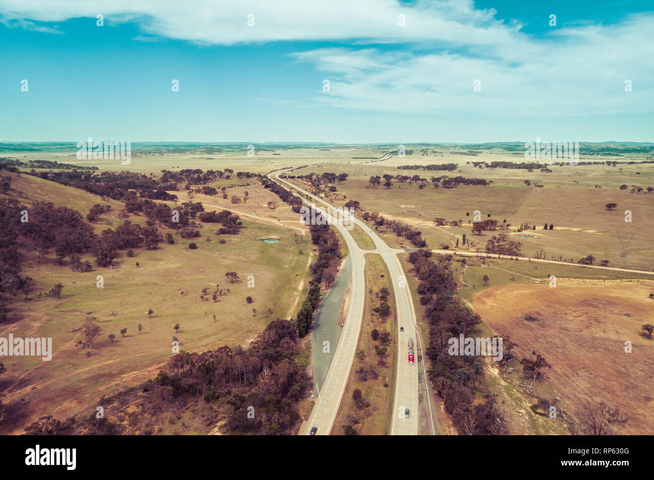 Aerial view of cars and trucks driving on Hume Highway among