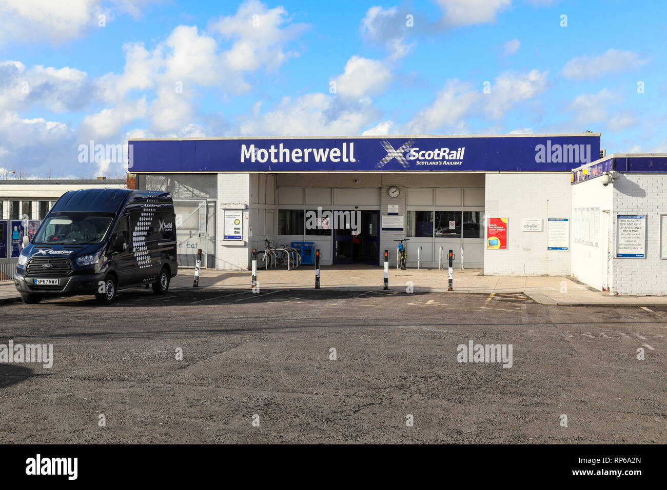 Motherwell railway station in North Lanarkshire with a Scotrail van in the car park - Stock Image