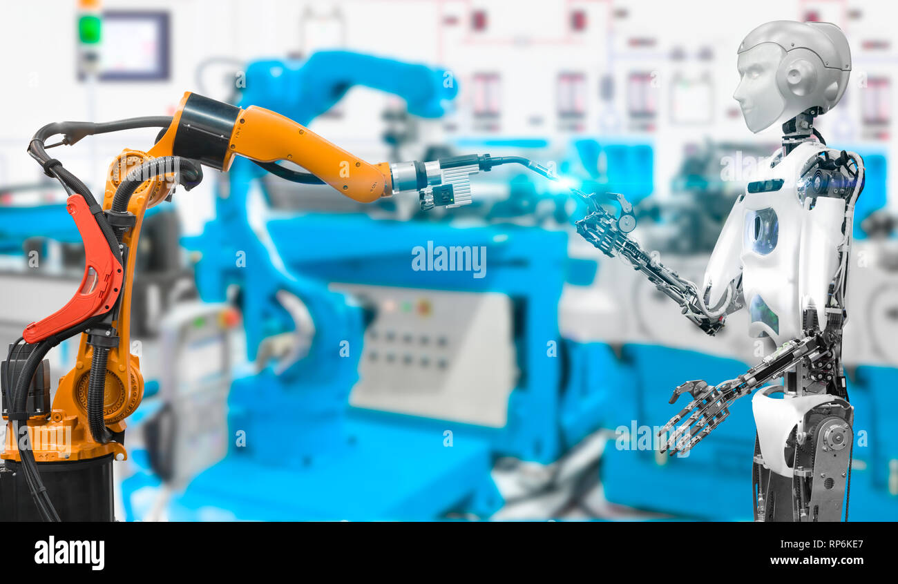 Humanoid robot with welding robot in an industrial of smart factory, Future technology concept - Stock Image
