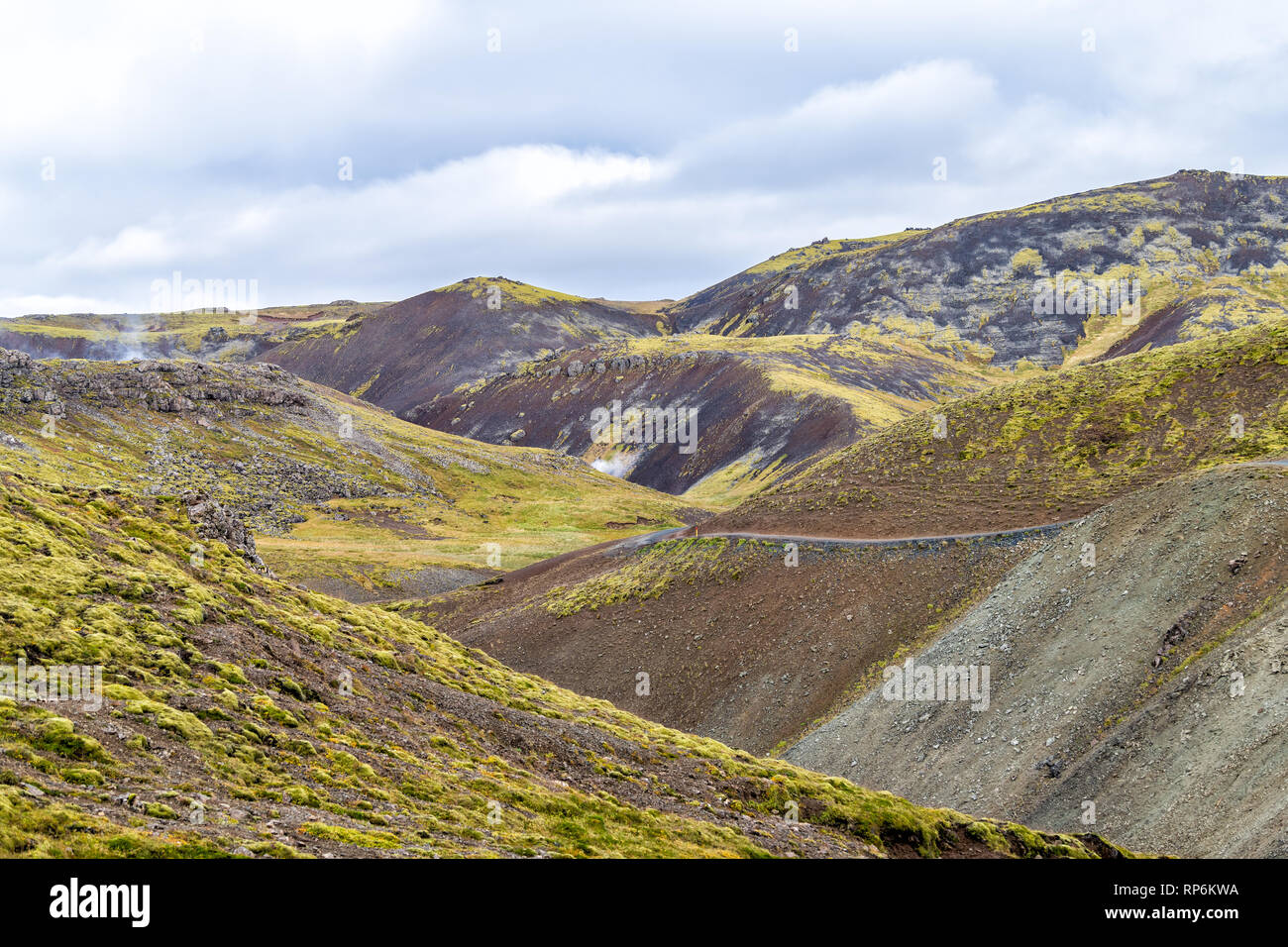 Reykjadalur, Iceland Hveragerdi Hot Springs steam fumarole vents during day in golden circle with nobody and barren rocky landscape - Stock Image
