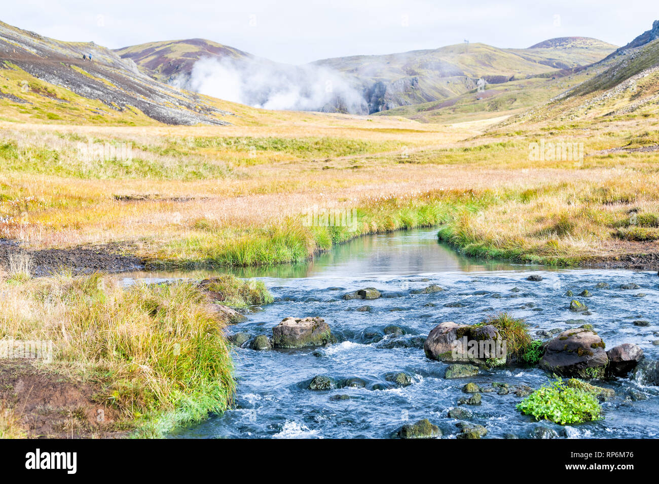 Hveragerdi Hot Springs river creek in Reykjadalur morning day in south Iceland golden circle with steam vent fumarole landscape and vapor mist - Stock Image