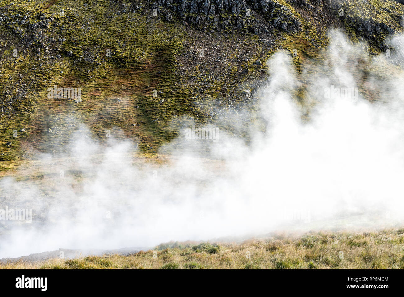Reykjadalur, Iceland Hveragerdi Hot Springs abstract closeup of steam fumarole vent during autumn day in golden circle with nobody on hiking trail - Stock Image