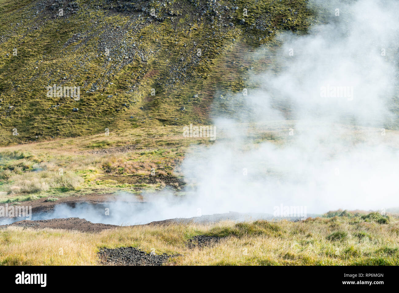 Reykjadalur, Iceland Hveragerdi Hot Springs abstract closeup of steam fumarole vent vapor during autumn day in golden circle with nobody on hiking tra - Stock Image