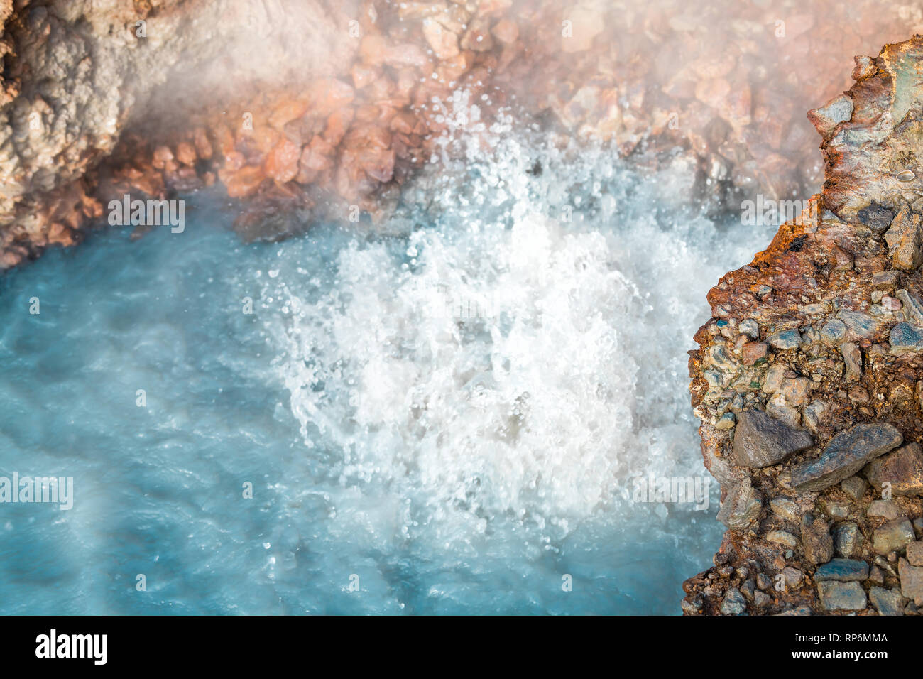 Reykjadalur, Iceland Hveragerdi Hot Springs abstract closeup of turquoise color steam fumarole vent in golden circle with nobody on hiking trail - Stock Image