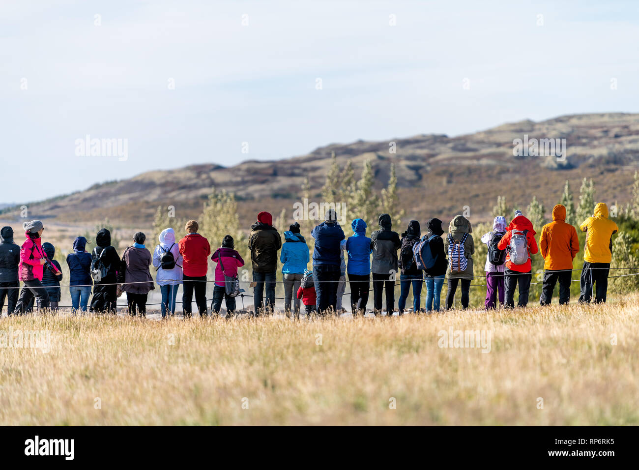 Haukadalur Valley, Iceland - September 19, 2018: Geyser landscape with back of many people tourists waiting in south Icelandic country by Strokkur Gey Stock Photo