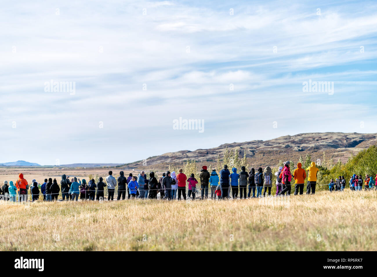 Haukadalur Valley, Iceland - September 19, 2018: Geyser landscape with back of many crowd people tourists waiting in Icelandic by Strokkur Geysir Hot  Stock Photo