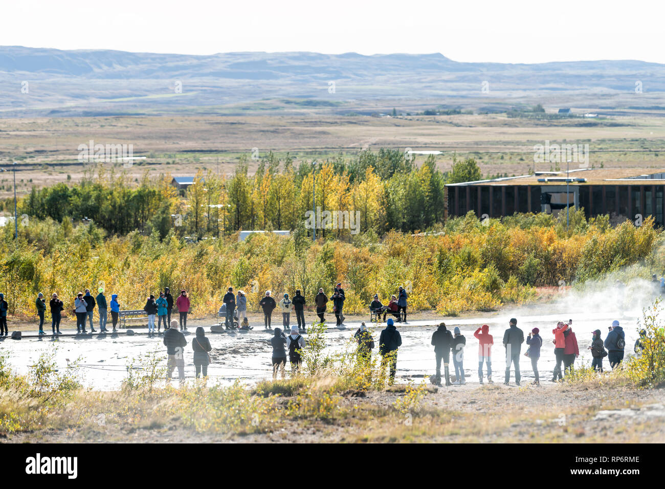 Haukadalur Valley, Iceland - September 19, 2018: Geyser landscape with people tourists waiting by Strokkur Geysir Hot Springs eruption on Golden Circl Stock Photo