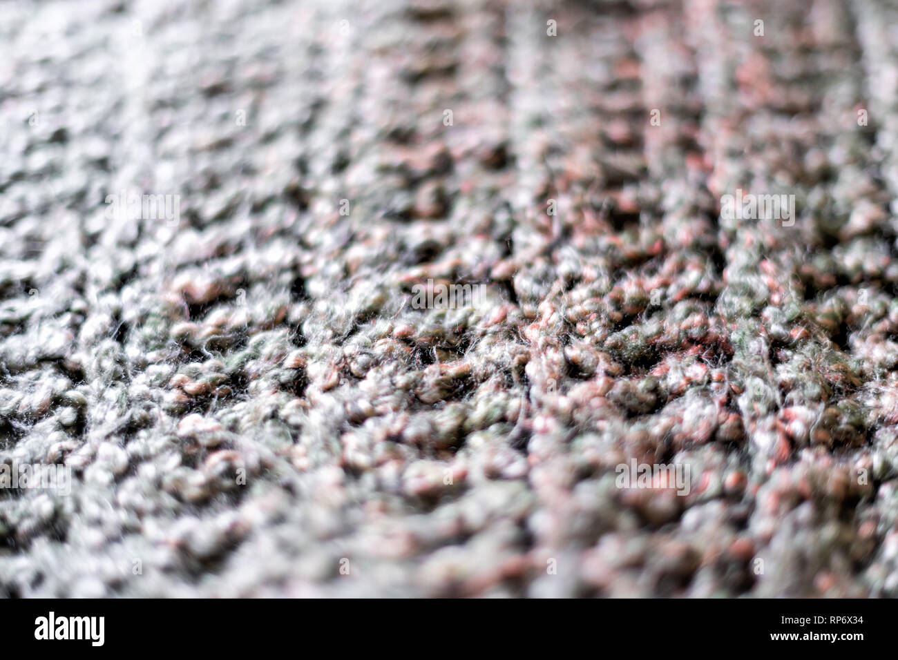 f8dc59e62b467a Macro abstract closeup texture of yarn knitted sweater or scarf handmade  with pink and grey colors