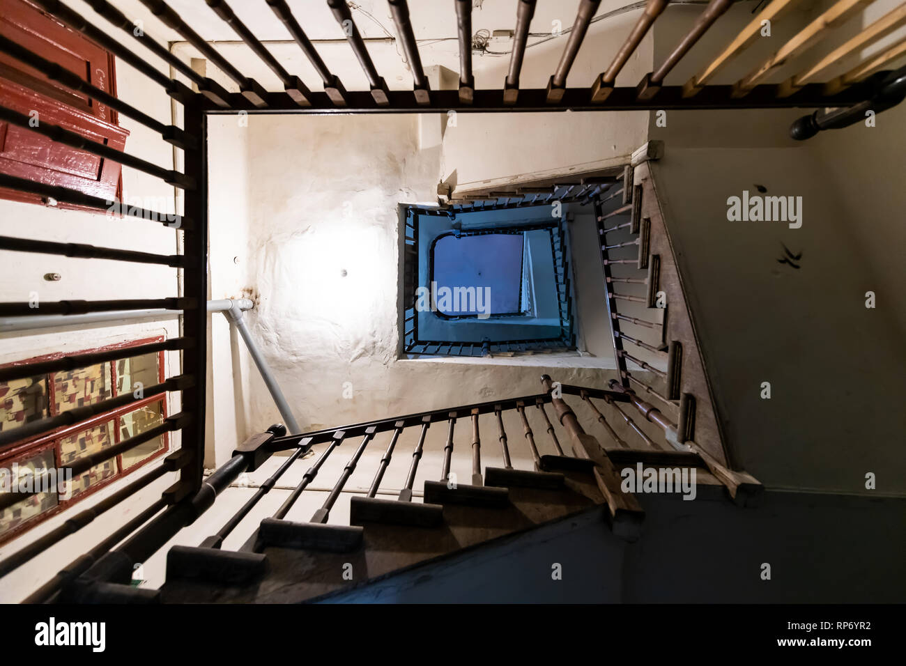 Low angle looking up of old vintage staircase light and grey concrete color flat top bottom view in Europe with nobody abstract pattern architecture - Stock Image