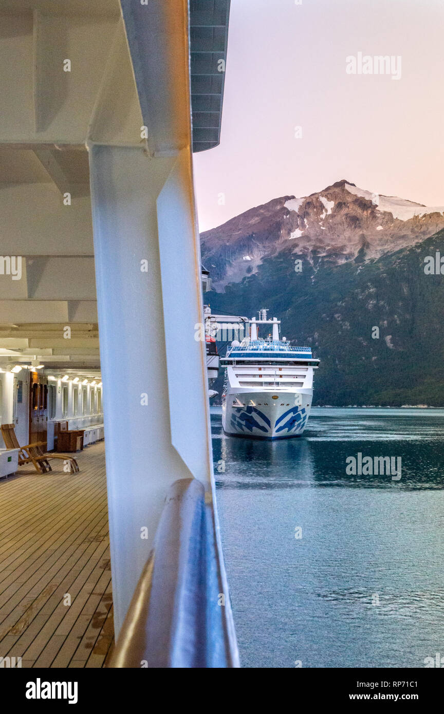 September 15, 2018 - Skagway, AK: Early morning cruise ships docking in Taiya Inlet with dawn light on mountains in background. Photographed from the  - Stock Image