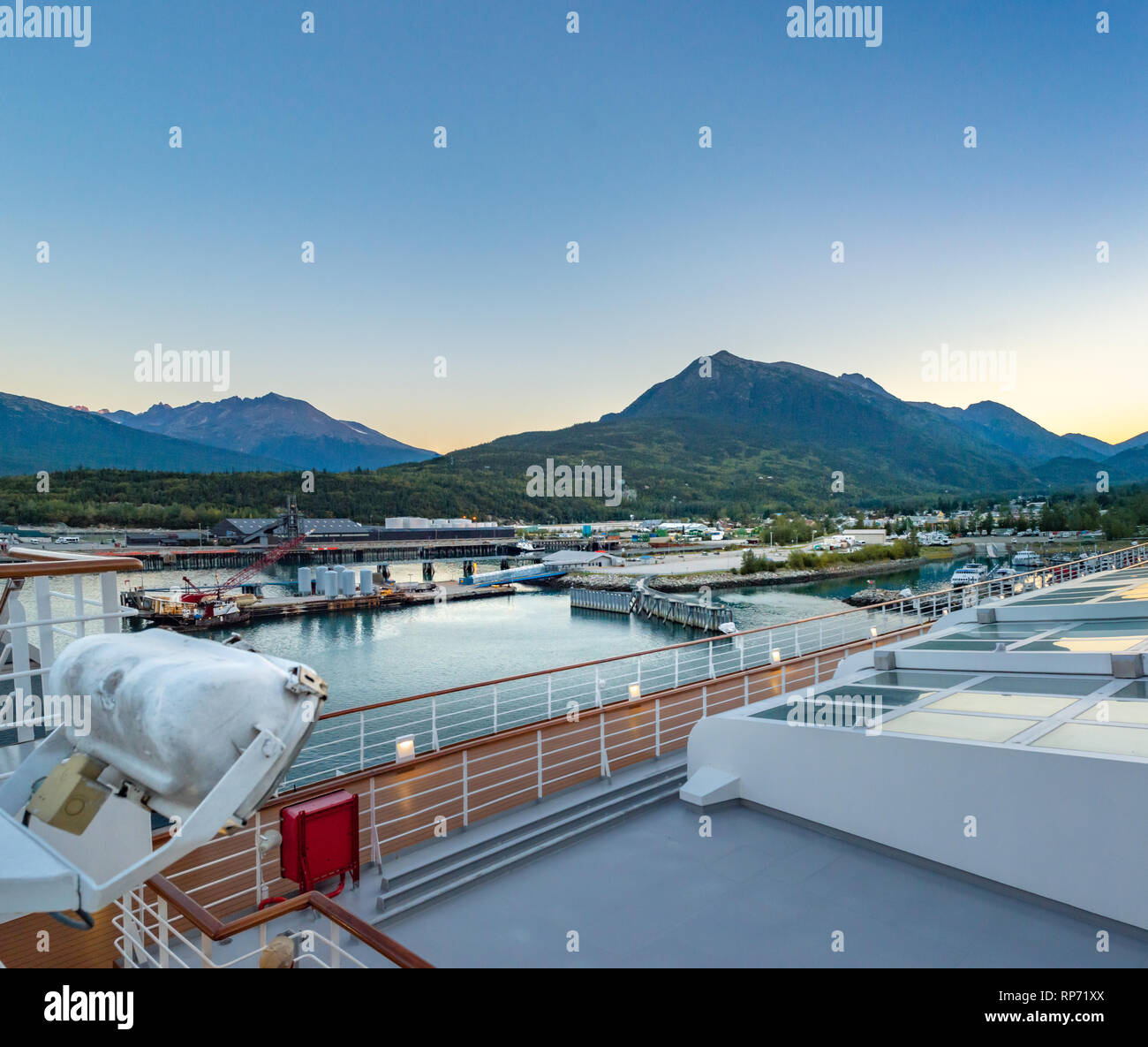 September 15, 2018 - Skagway, AK: Harbour and mountins at dawn from deck of Holland America's The Volendam cruise ship. - Stock Image