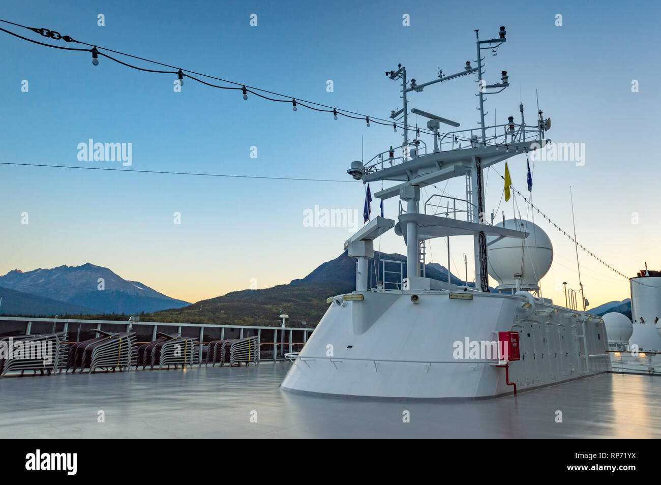 September 15, 2018 - Skagway, AK: Navigation, radar and positioning structure at sunrise, on top of Holland America's The Volendam cruise ship. - Stock Image