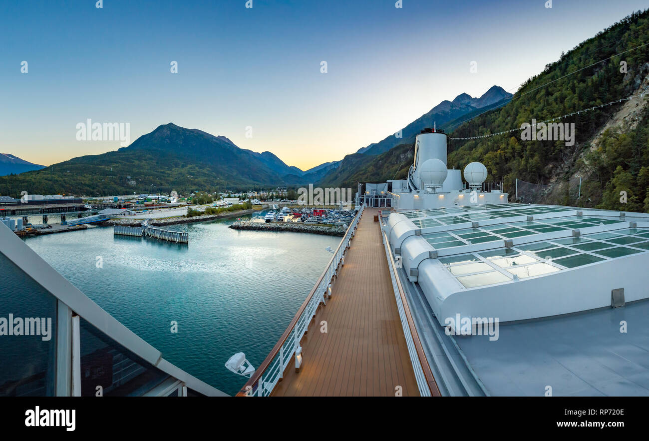 September 15, 2018 - Skagway, AK: Small boat harbour, Sports Deck and closed Magrodome of Holland America's The Volendam, while docking at port. - Stock Image