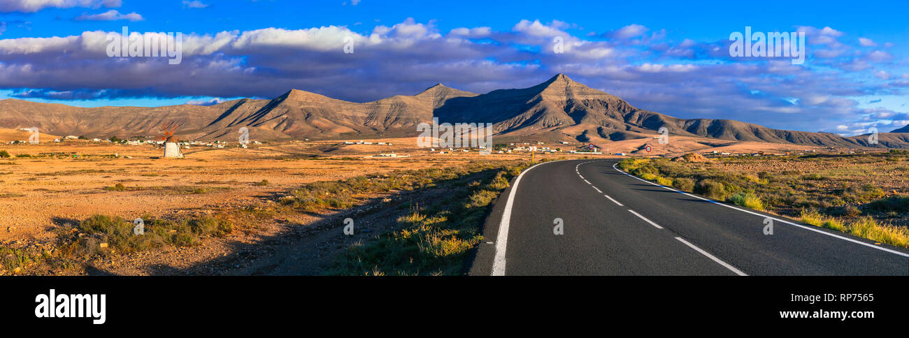 Fuerteventura travel - scenic landscapes of volcanic island, view with traditional windmill. Canary islands Stock Photo