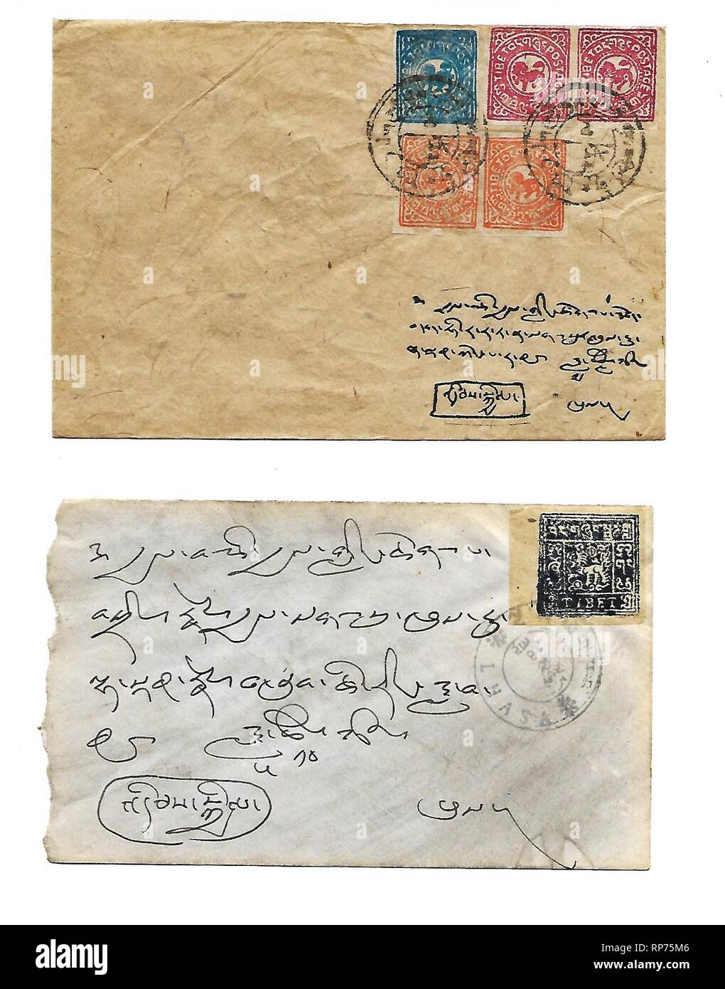 Stamped envelopes mailed in independent Tibet, possibly as late as the mid-1950s. Tibet was not a member of the Universal Postal Union, so that letters sent abroad had to be carry Indian stamps also. - Stock Image