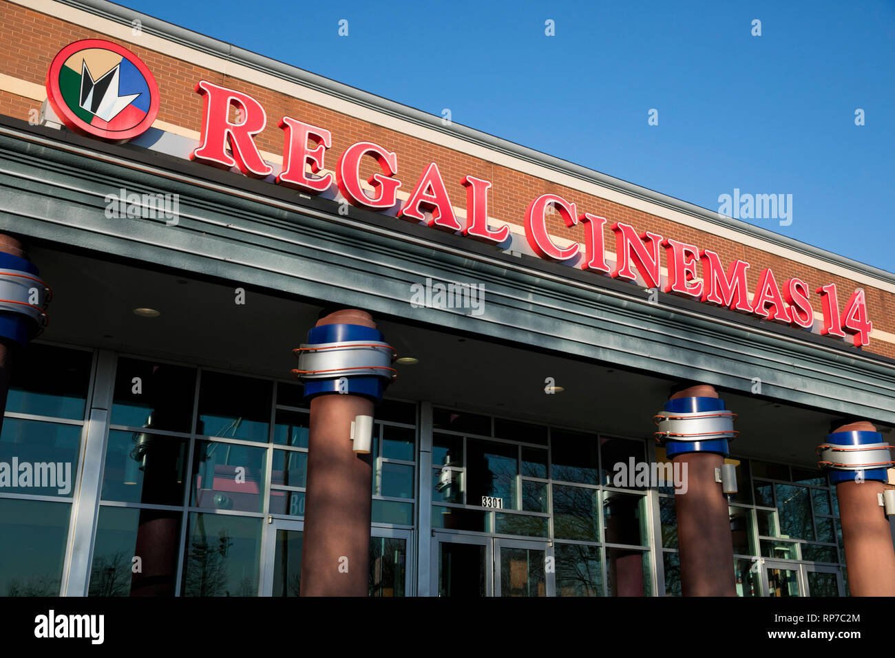 A logo sign outside of a Regal Cinemas movie theater location in