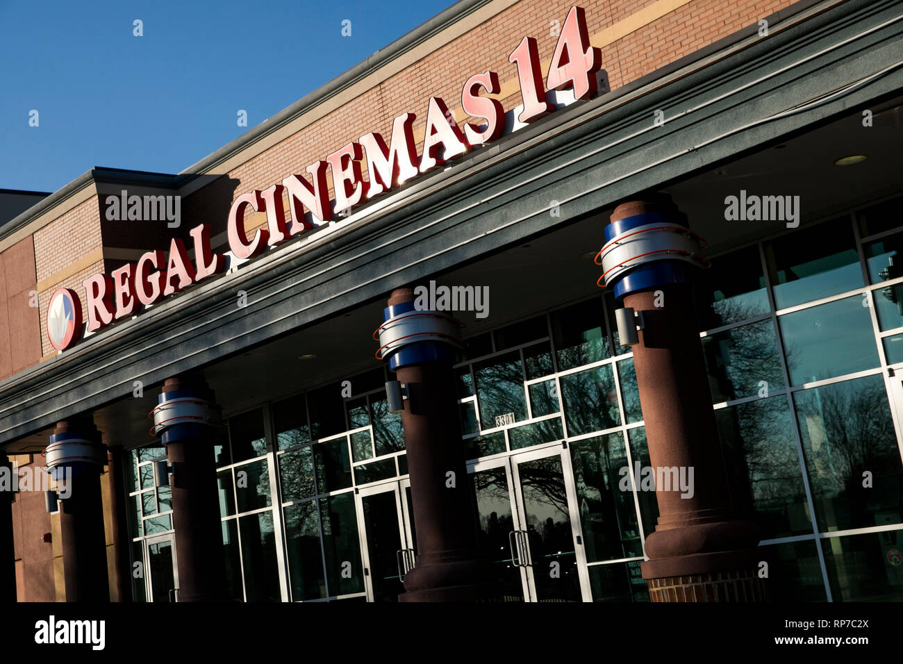 A logo sign outside of a Regal Cinemas movie theater location in Fredericksburg, Virginia on February 19, 2019. - Stock Image