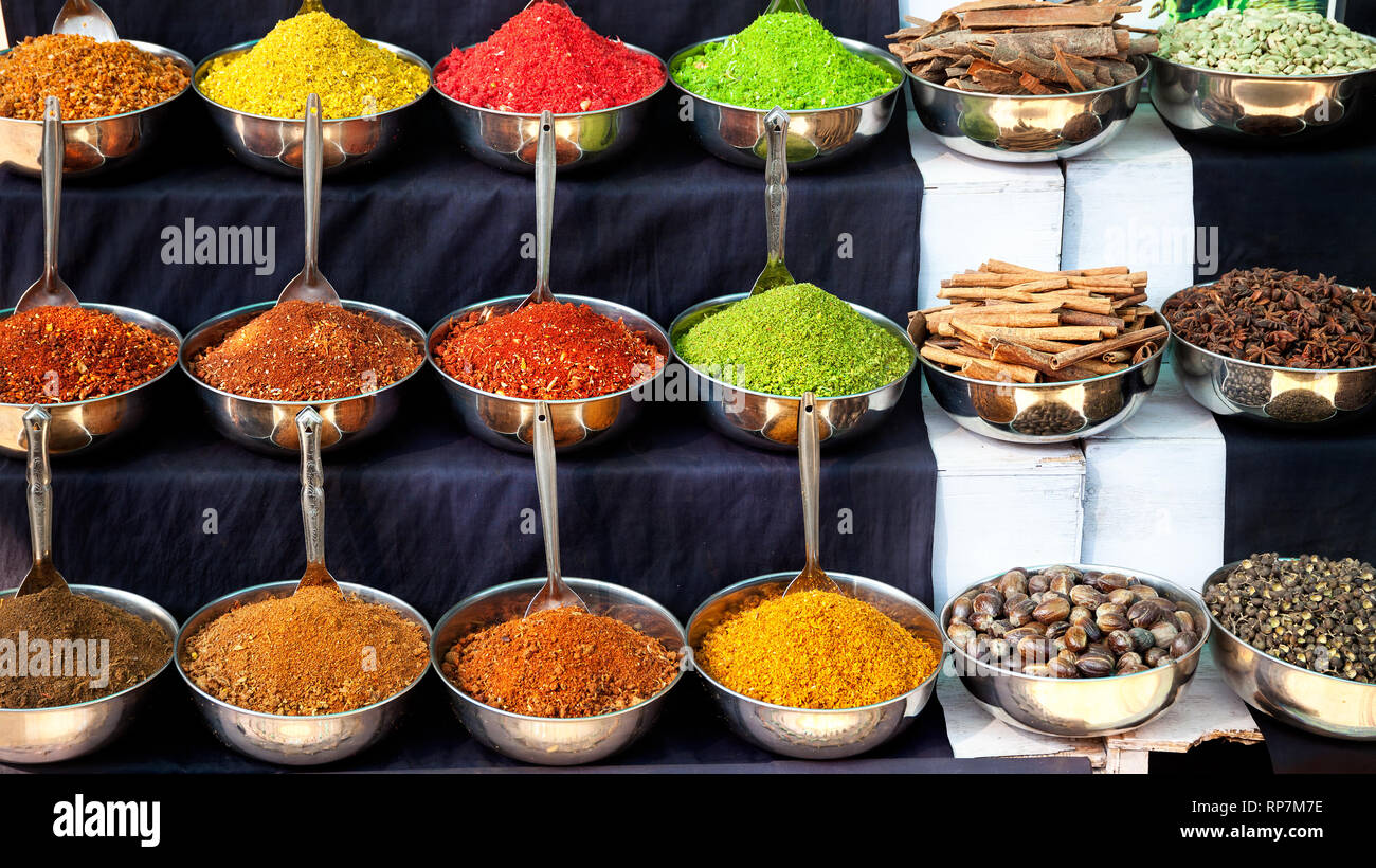 Indian colored spices at market in Goa, India - Stock Image