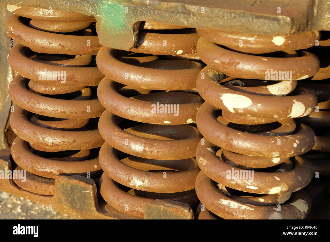 Coil springs on a railroad car; springs on a freight train; Bryan, Texas, USA. - Stock Image