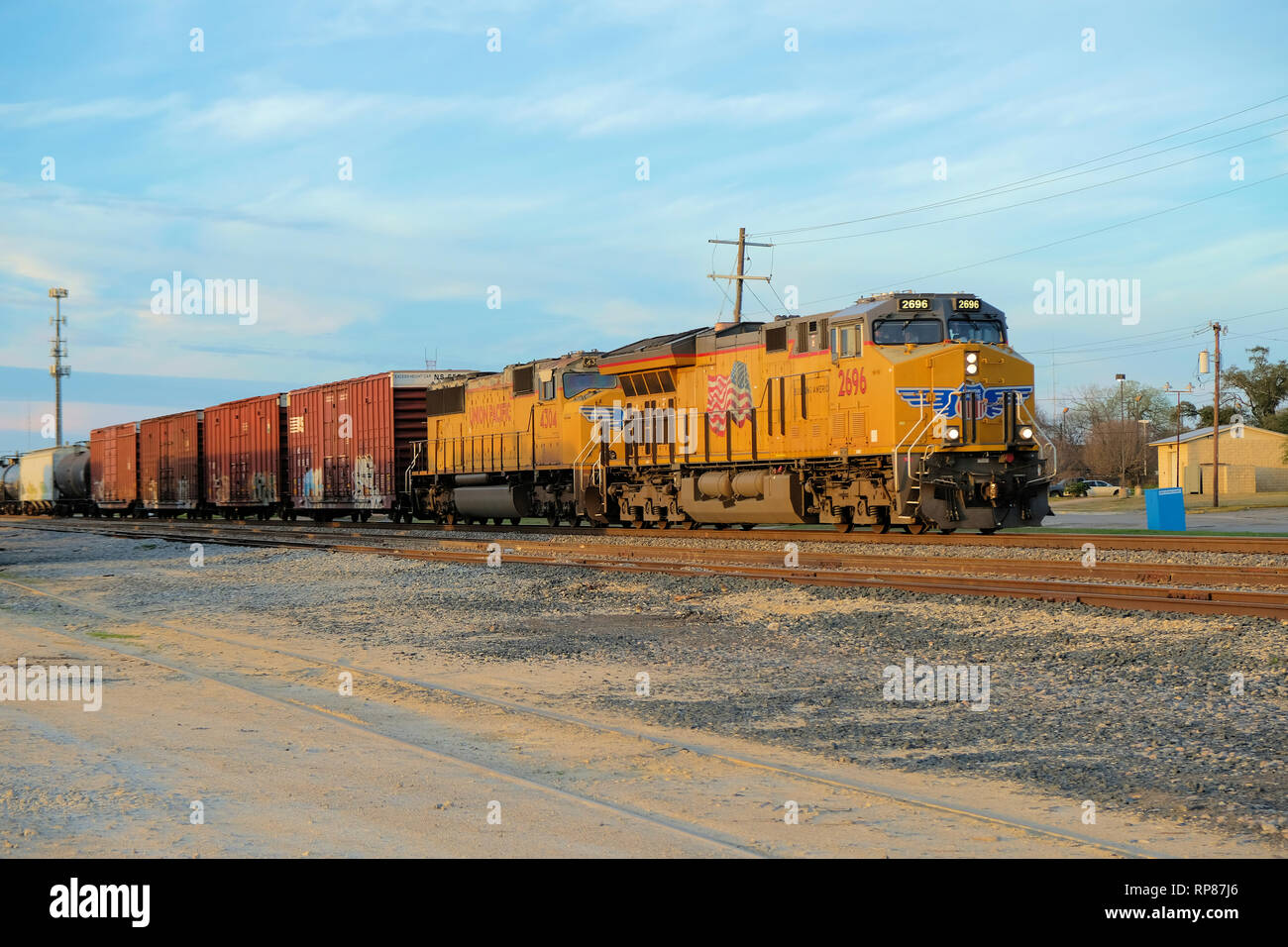 Union Pacific locomotive engine number 2696 pulling freight cars through Bryan, Texas, USA. - Stock Image