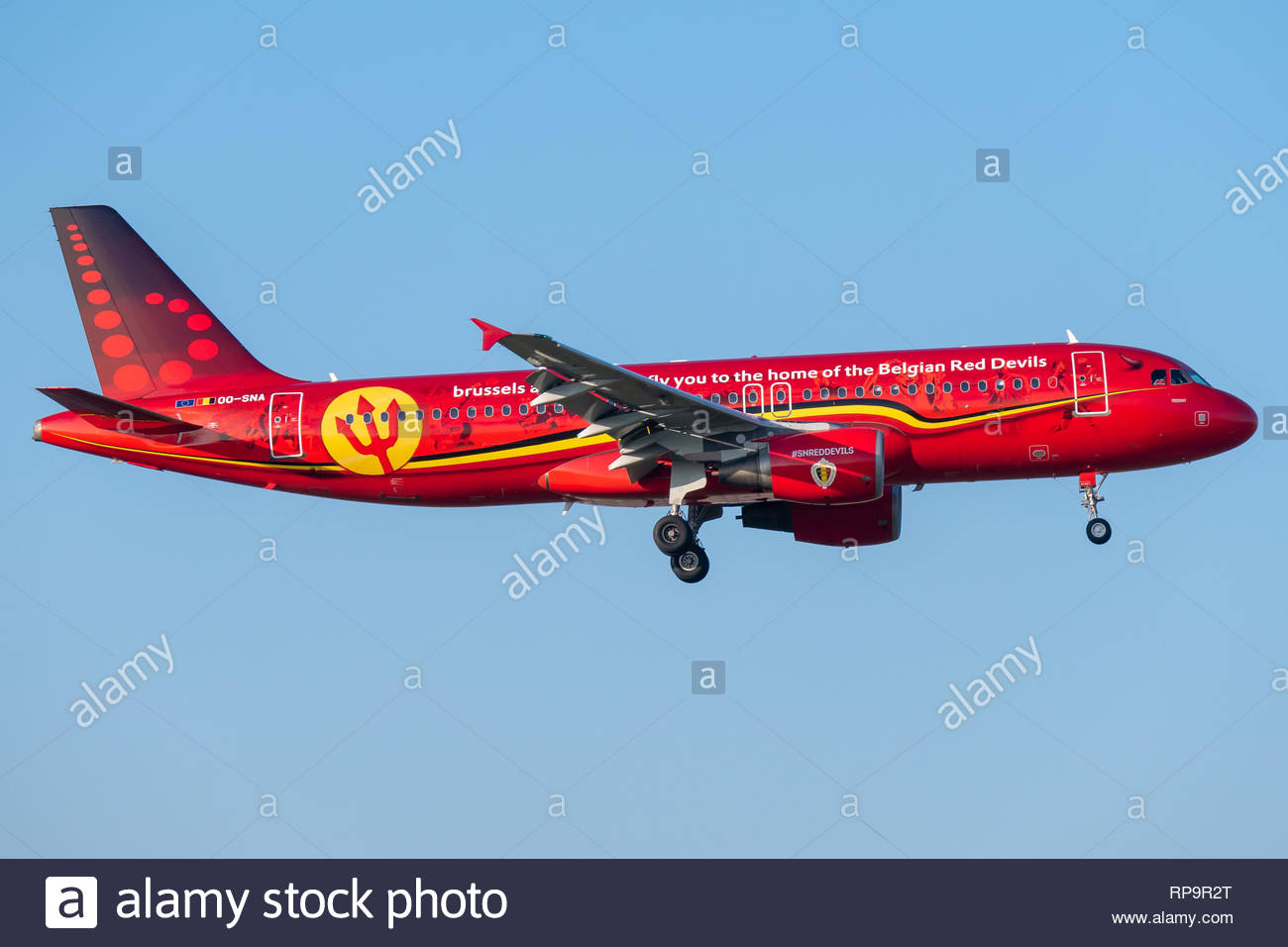 A Brussels Airlines Airbus A320 on short final for runway 07 at Brussels International Airport, wearing a special RED DEVILS livery - Stock Image
