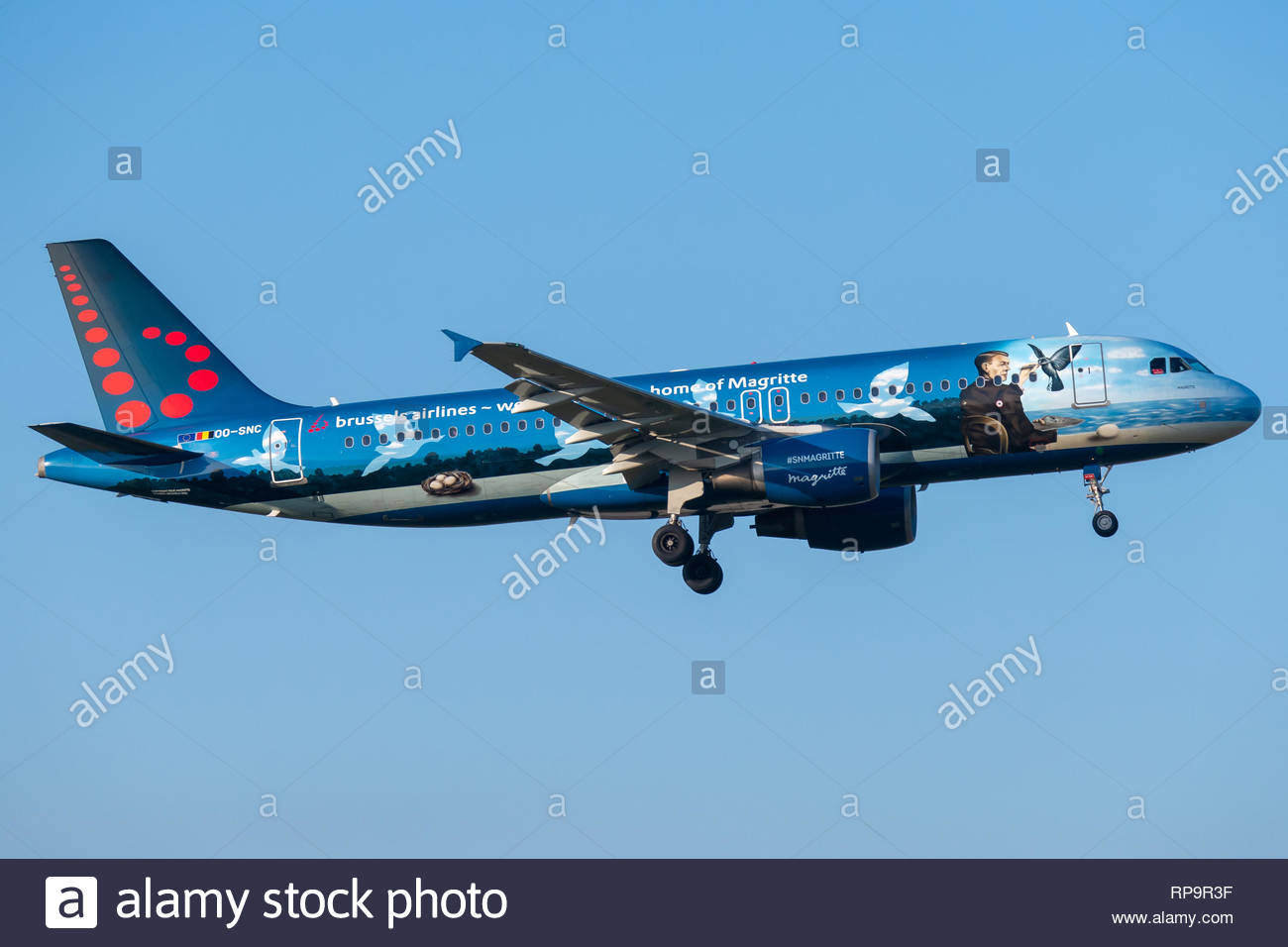 A Brussels Airlines Airbus A320 on short final for runway 07 at Brussels International Airport, wearing a special MAGRITTE livery - Stock Image