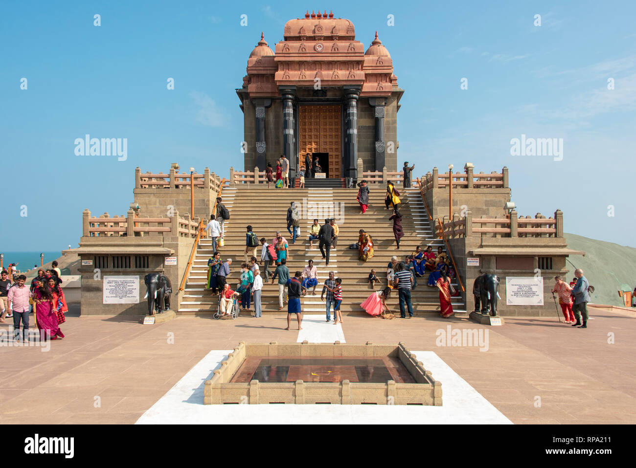 Tourists and local people visiting the Vivekananda Rock Memorial in Kanyakumari on a sunny day with blue sky. - Stock Image