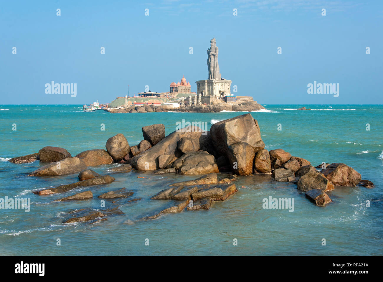 A view of the Vivekananda Rock Memorial  and Thiruvalluvar Statue near the town of Kanyakumari on a sunny day with blue sky. - Stock Image