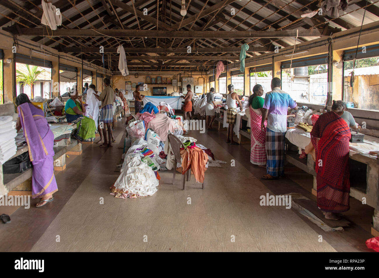 Workers working ironing at the Dhobi khana public laundry in fort Kochi. - Stock Image
