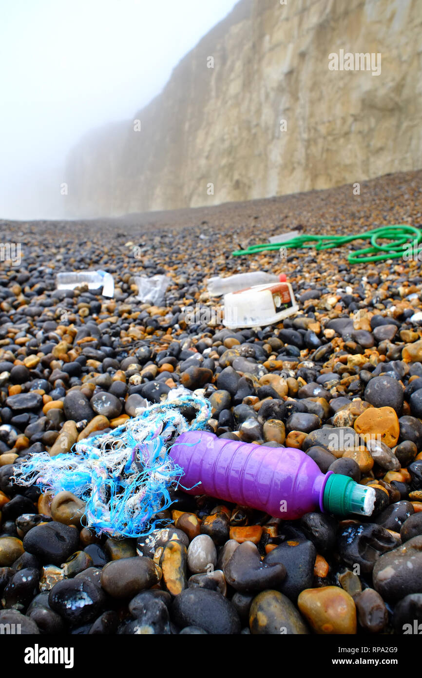 Plastic washed up on a pebble beach, Newhaven, East Sussex. - Stock Image